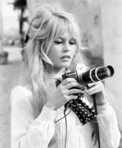 Brigitte Bardot with a Camera